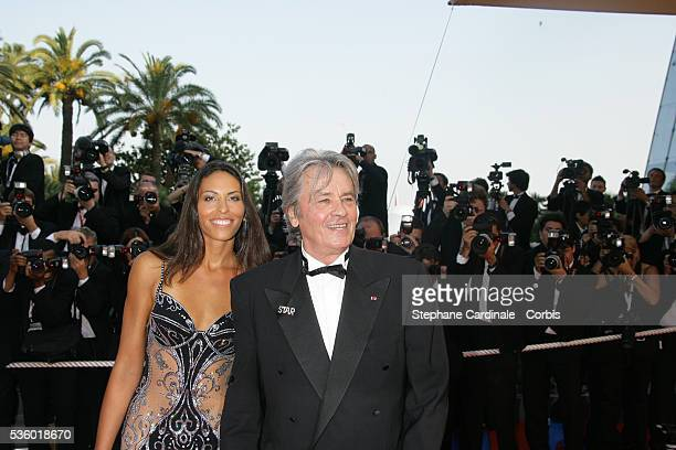 Alain Delon and date arrive at the premiere of 'Chacun Son Cinema' during the 60th Cannes Film Festival