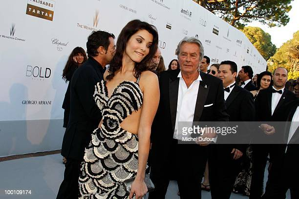 Alain Delon and guest arrive at amfAR's Cinema Against AIDS 2010 benefit gala at the Hotel du Cap on May 20 2010 in Cannes France