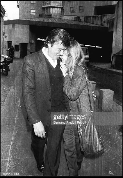 Alain Delon and his partner Catherine Pironi going to sculptor Paul Belmondo's exhibition