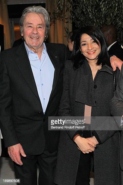 Alain Delon and Jeannette Bougrab attend 'La Petite Maison De Nicole' Inauguration Cocktail at Hotel Fouquet's Barriere on January 22 2013 in Paris...