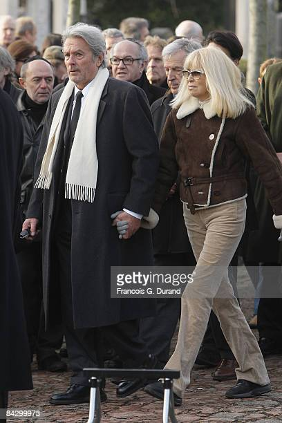 Alain Delon and Mireille Darc attend Producer and Actor Claude Berri's Funeral on January 15 2009 in Paris
