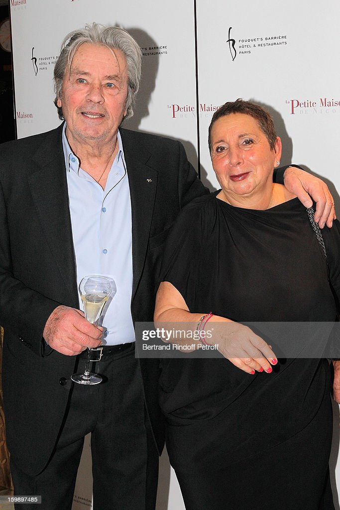 Alain Delon (L) and Nicole Rubi attend 'La Petite Maison De Nicole' Inauguration Photocall at Hotel Fouquet's Barriere on January 22, 2013 in Paris, France.
