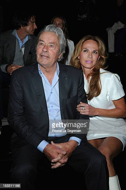 Alain Delon and Rosalie van Breemen attend the Elie Saab Spring/Summer 2013 show as part of Paris Fashion Week at Espace Ephemere Tuileries on...
