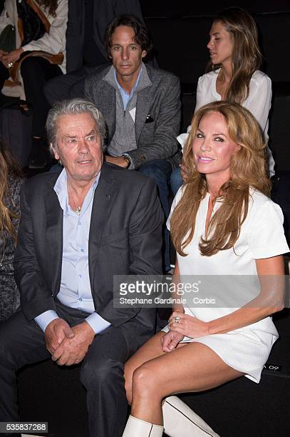 Alain Delon and Rosalie Van Breemen attend the Elie Saab Spring/Summer 2013 show as part of Paris Fashion Week in Paris