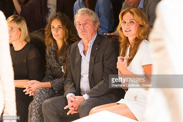 Alain Delon and Rosalie Van Breemen attend the Elie Saab Spring/Summer 2013 show as part of Paris Fashion Week in Paris