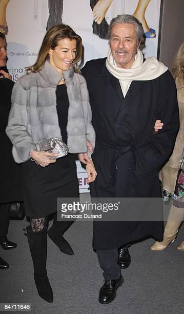 Alain Delon and Valerie Hortefeux attend Le Code Change Paris premiere on February 9 2009 in Paris France