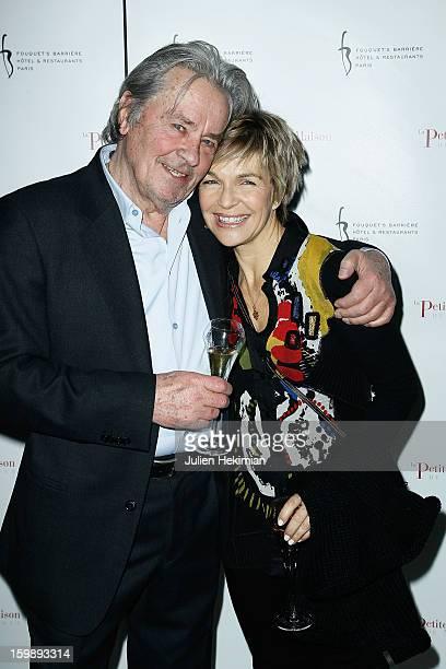 Alain Delon and Veronique Jannot attend 'La Petite Maison De Nicole' Inauguration Photocall at Hotel Fouquet's Barriere on January 22 2013 in Paris...