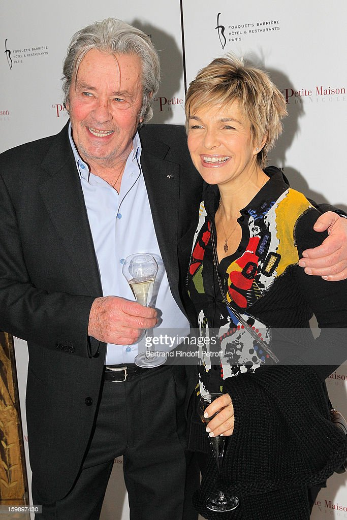 Alain Delon (L) and Veronique Jannot attend 'La Petite Maison De Nicole' Inauguration Photocall at Hotel Fouquet's Barriere on January 22, 2013 in Paris, France.
