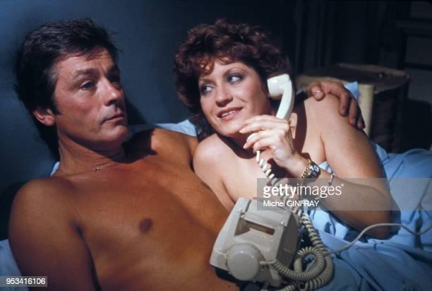 Alain Delon et Andréa Ferréol sur le tournage du film 'Le Battant' réalisé par lui même et Robin Davis en 1983 France