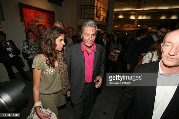 Alain Delon French actor and Anouchka his daughter attend a cocktail party at the Hotel DrouotMontaigne in Paris France on October 11st 2007