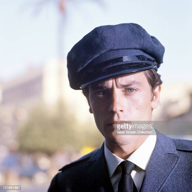 Alain Delon, French actor, as a chauffeur in the film 'Joy House', 1964.