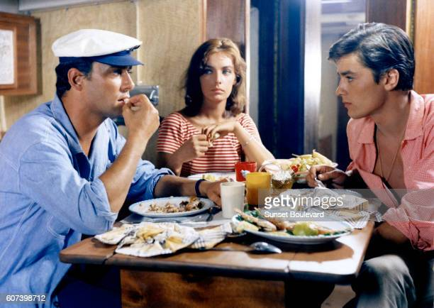 """Alain Delon, Marie Laforet and Maurice Ronet on the set of """"Plein Soleil""""."""