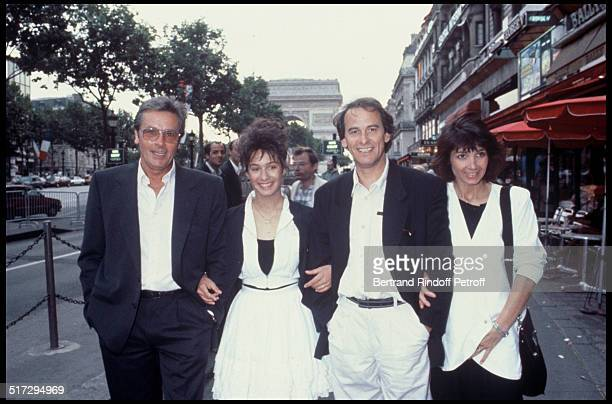 "Alain Delon, Marie, Michel Fugain and his wife Stephanie on the Champs Elysees for the premiere of the movie ""Thank You Satan""."