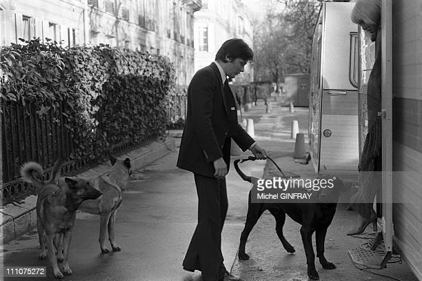 Alain Delon Mireille Darc with their dogs Jabo Manu and Lippy in Paris France in February 1977