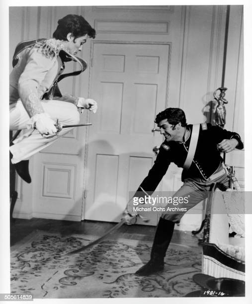 Alain Delon moves to stab is opponent in a scene from the Universal Studio movie Texas Across the River circa 1966