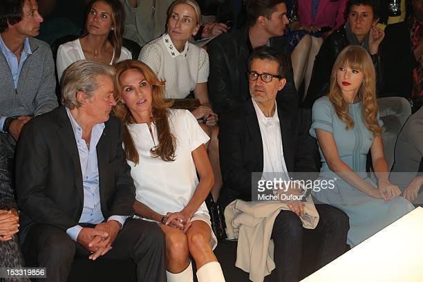 Alain Delon Rosalie van Dreemen guest and Taylor Swift attend the Elie Saab Spring/Summer 2013 show as part of Paris Fashion Week at Espace Ephemere...