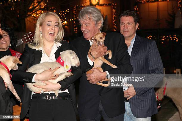 Alain Delon with dog and Kathrin Glock with lamb Francis Fulton Smith during the Opening of the Gut Aiderbichl Christmas Market on November 11 2014...