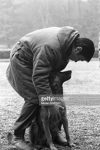 Alain Delon with his dog in the shooting of 'Mr Klein' at the castle Escrinot in France on September 02nd 1976