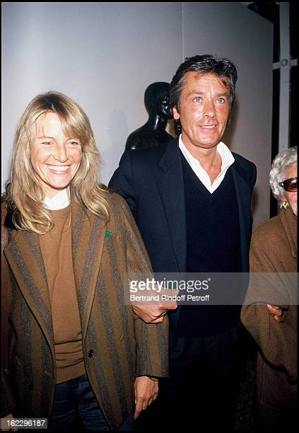 Alain Delon with his girlfriend Catherine Pironi at sculptor Paul Belmondo's exhibition