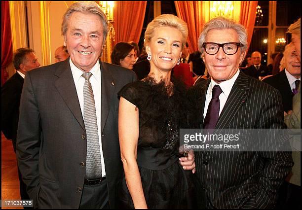 Alain Delon with Jean Daniel Lorieux and Laura Restelli at The Association Adicare Gala Dinner Held At The Salon De L'Horloge Du Palais Des Affaires...
