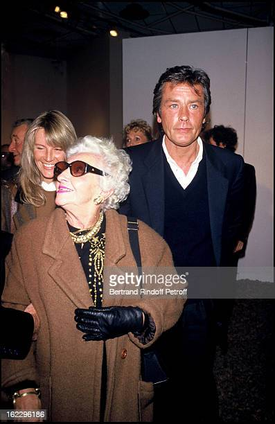 Alain Delon with JeanPaul Belmondo's mother Madeleine and his girlfriend Catherine Pironi at sculptor Paul Belmondo's exhibition