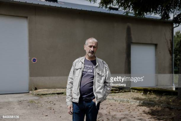 Alain Dubois worker at the GMS automobile parts factory looks on as he stands outside the auto component factory in La Souterraine La Creuse region...