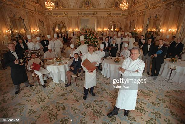 Alain Ducasse with his staff at the Louis XV res taurant in Monaco