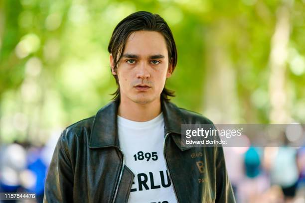 Alain Fabien Delon wears a leather jacket a white Berluti tshirt outside Berluti during Paris Fashion Week Menswear Spring/Summer 2020 on June 21...