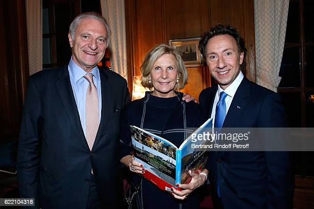 Alain Flammarion his wife Suzanna and Stephane Bern attend Stephane Bern signs his Book 'Mon Luxembourg' at Residence of the Ambassador of Luxembourg...