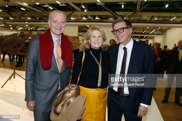 Alain Flammarion his wife Suzanna Flammarion and President of Centre Pompidou Serge Lasvignes attend the Cesar Retrospective at Centre Pompidou on...