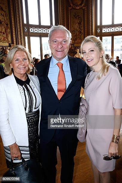 Alain Flammarion standing between his wife Suzanna and Wife of Italy's Ambassador to France Giada Magliano attend Cyril Karaoglan receives the Medal...