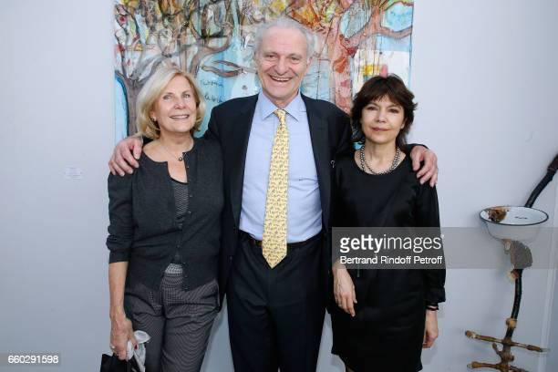 Alain Flammarion standing between his wife Suzanna Flammarion and galerist Nathalie Obadia attend the 'Art Paris Art Fair' Exhibition Opening at Le...