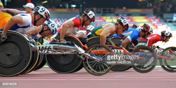 Alain Fuss of France lines up with other racers at the start of heats of the men's 1500 metre T54 classification event at the 2008 Beijing Paralympic...