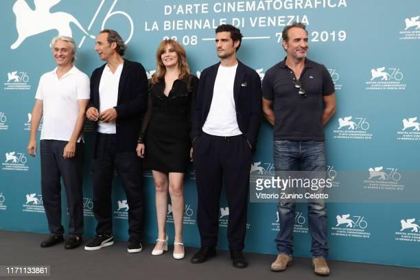 Alain Goldman Alexandre Desplat Louis Garrel Emmanuelle Seigner and Jean Dujardin attend J'Accuse photocall during the 76th Venice Film Festival at...