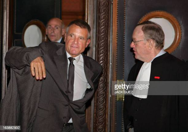 Alain Gomez French defence firm Thomson former CEO leaves with his lawyer Olivier Metzner Paris tribunal 14 November 2005 at the end of the first day...