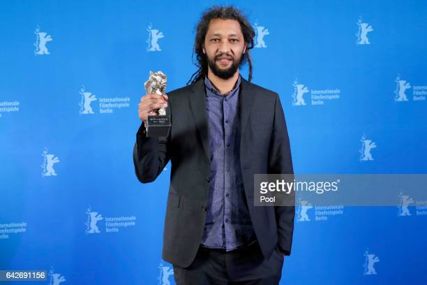 Alain Gomis holding the Silver Bear Grand Jury Prize for Felicite backstage after the closing ceremony of the 67th Berlinale International Film...
