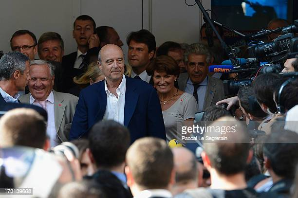 Alain Gournac and Alain Juppe depart the UMP headquarters after an extraordinary meeting of UMP rightwing opposition party July 8 2013 in Paris France