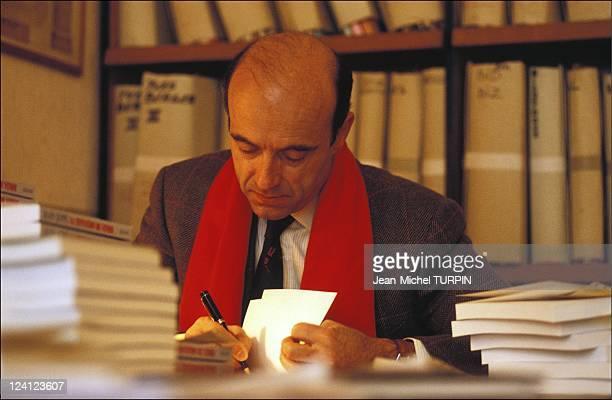 Alain Juppe autographs his book 'La tentation de Venise' in Paris France on January 26 1993