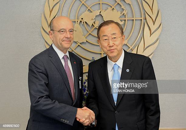 Alain Juppe Foreign Minister of France shakes hands with United Nations Secretary General Ban Kimoon June 7 2011 at UN headquarters in New York AFP...