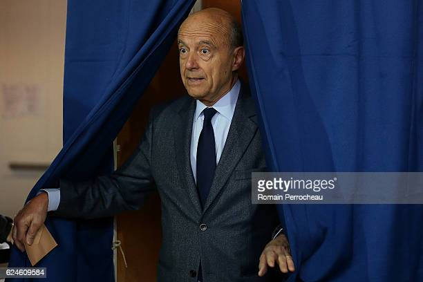 Alain Juppe Mayor of Bordeaux and Les Republicains presidential candidate hopeful votes during the first round of voting in the Republican Party's...