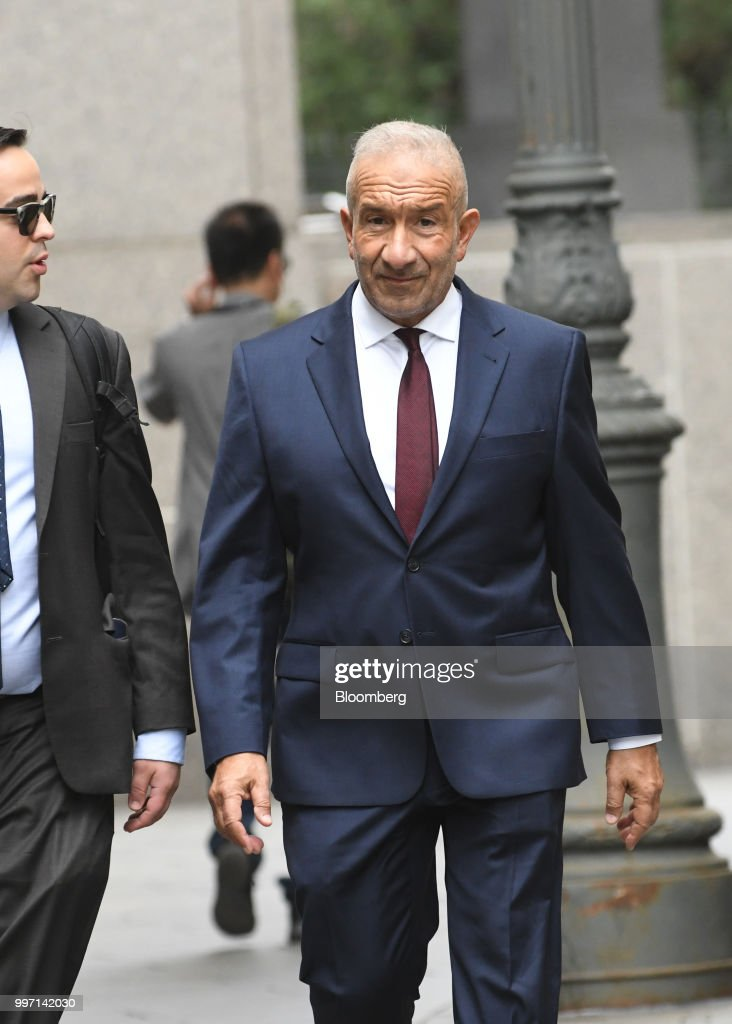 Alain Kaloyeros, former president of the State University of New York's Polytechnic Institute, arrives at federal court in New York, U.S., on Thursday, July 12, 2018. Kaloyeros is accused of conspiring with construction and real estate executives from COR Development in Syracuse and LPCiminelli inBuffalo to rig bids for lucrative projects in Buffalo and Syracuse tied to the Buffalo Billion project, a New York state government project led by Governor Andrew Cuomo. Photographer: Louis Lanzano/Bloomberg via Getty Images
