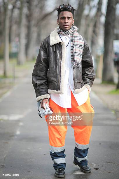 Alain Kvbrvl wears a Burberry scarf vintage clothes and Doc Martens shoes after the Chloe show during Paris Fashion Week Womenswear Fall Winter...