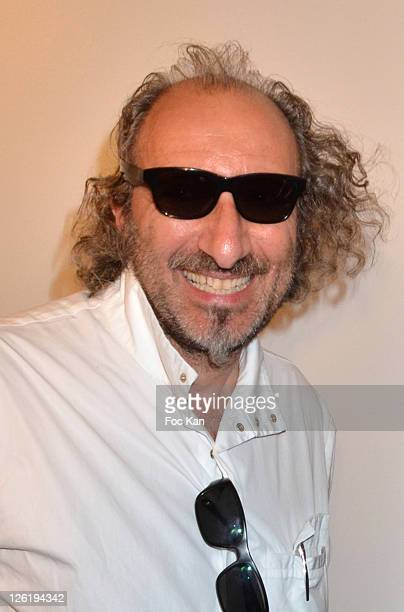 Alain Mikli attends the JeanPaul Gaultier Eyeglasses by Mikli Launch Cocktail at Mikli Flagship Store St Peres on September 22 2011 Paris France