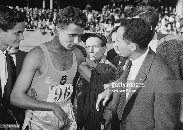 Alain Mimoun Congratulating Michel Jazy After His New Record At Paris In France On October 4Th 1962