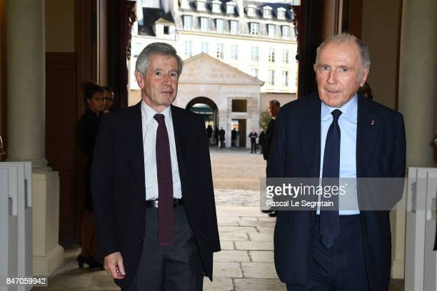 Alain Minc and Francois Pinault attend the exhibition 'Faire Avec' works from the Pinault Collection at 40 Rue de Sevres on September 14 2017 in...
