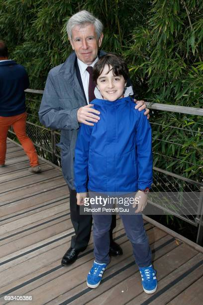 Alain Minc and his grandson Gabriel attend the 2017 French Tennis Open Day Eleven at Roland Garros on June 7 2017 in Paris France