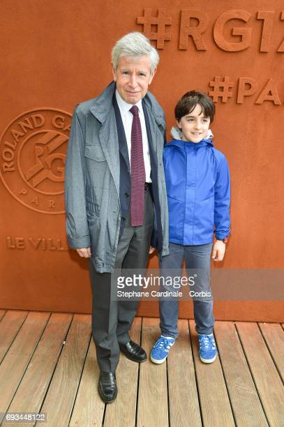 Alain Minc and his Grandson Gabriel attend the 2017 French Tennis Open_Day Eleven at Roland Garros on June 7 2017 in Paris France