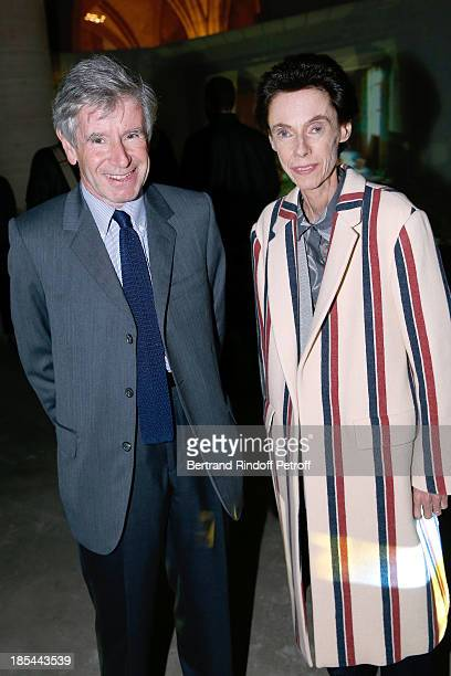 Alain Minc and his wife attend 'A Triple Tour' Francois Pinault Collection Exhibition opening at the Conciergerie on October 20 2013 in Paris France