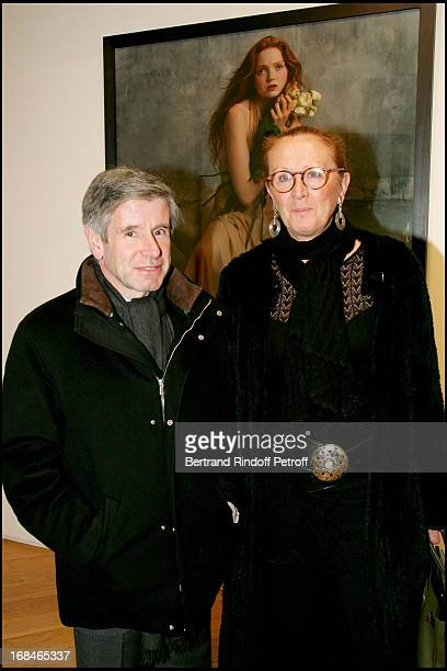 Alain Minc and Mrs Philippe Augier at Opening Of The Exhibition Bettina Rheims Heroes In Paris
