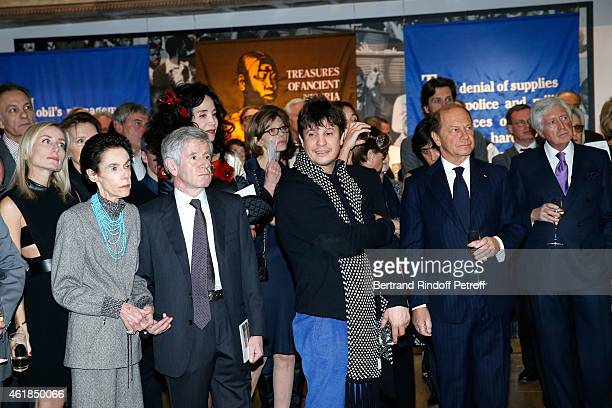 Alain Minc his wife and Contemporary Artist Adel Abdessemed attend the Societe des Amis du Musee National d'Art Moderne Dinner at Beaubourg on...